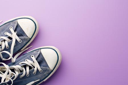 Photo pour vintage sneakers on violet background - image libre de droit
