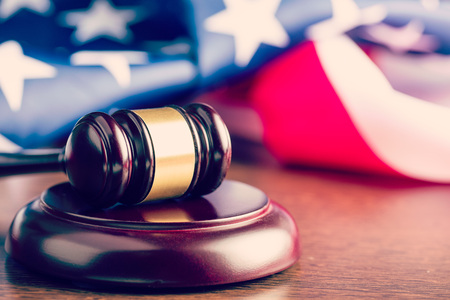 Photo pour the judge gavel and background with usa flag - image libre de droit