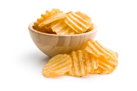 Foto für Crinkle cut potato chips isolated on white background. Tasty spicy potato chips in bowl. - Lizenzfreies Bild