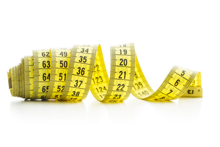 Photo pour The yellow measuring tape isolated on white background. - image libre de droit