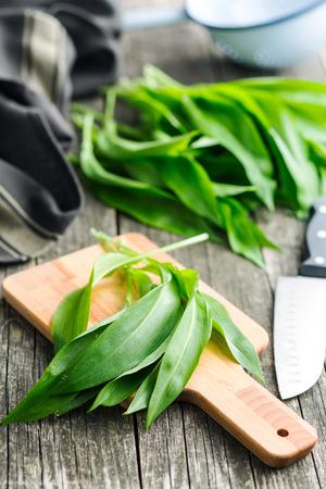 Ramson or wild garlic leaves on cutting board.