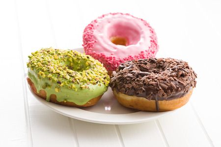 Photo for Three sweet donuts on plate. - Royalty Free Image