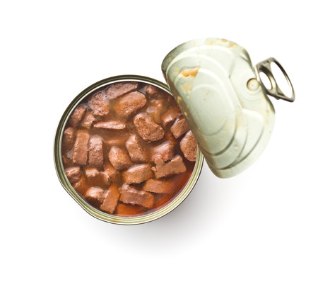 Foto de Meal for dog or cat. Canned meat with sauce in can isolated on white background. - Imagen libre de derechos