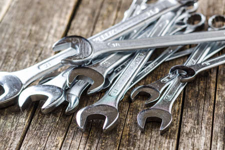 Foto per Chrome vanadium wrench. Industrial spanner on old wooden table. - Immagine Royalty Free
