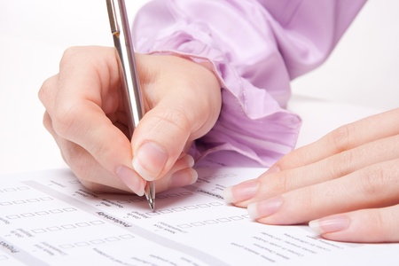 Photo pour Woman filling the form on job interview - image libre de droit