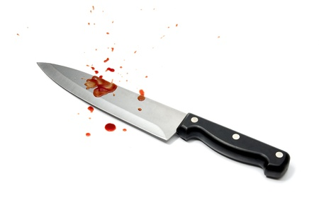Aggression - bloodstained knife on white background