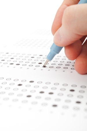 Student complete the questionnaire  filling the test form  - school exam concept and another test completing  new job interview, IQ test etc