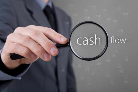 Focus on cash flow and audit of accounts concept. Businessman (auditor) analyze cash flow. Positive numbers fly up, negative numbers fly down.