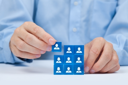 Human resources, social networking, assessment center concept, personal audit or CRM concept - recruiter complete team by one person  Employees are represented by blue glass cubes with icons
