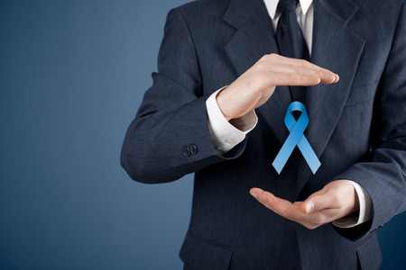Prostate cancer awareness, peace and genetic disorder awareness - man with protective and support gesture and blue ribbon.