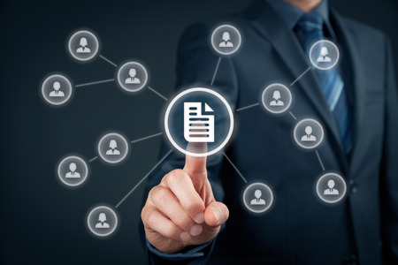 Foto de Corporate data management system (DMS) and document management system concept. Businessman click (or publish) on document connected with corporate users with access rights. - Imagen libre de derechos