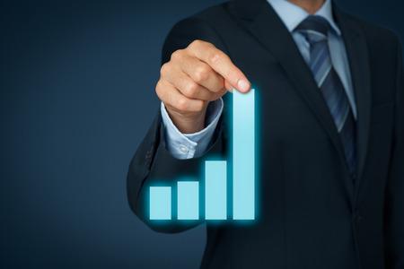 Foto de Businessman pull column of graph to improve business progress and success. - Imagen libre de derechos