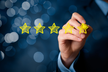 Photo for Review, increase rating or ranking, evaluation and classification concept. Businessman draw five yellow star to increase rating of his company. Bokeh in background. - Royalty Free Image