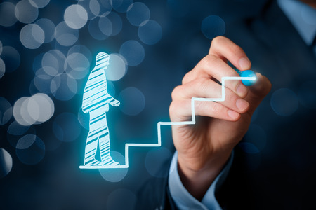 Personal development, personal and career growth, success, progress and potential concepts. Coach (human resources officer, supervisor) help employee with his growth symbolized by stairs, bokeh in background.