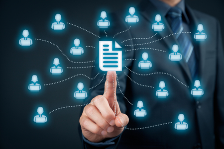 Foto de Corporate data management system (DMS) and document management system concept. Businessman click (or publish) on document connected with corporate users working on notebooks with access rights. - Imagen libre de derechos