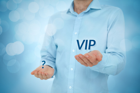 VIP person versus anonymous concept. Businessman hold VIP text in one hand and question mark in second hand.