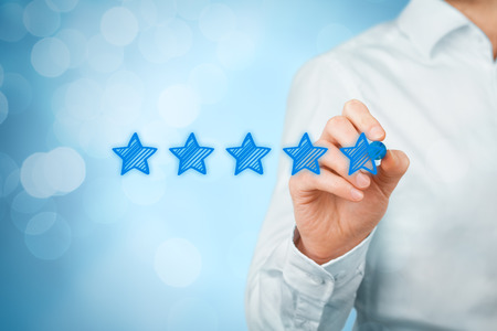 Photo pour Review, increase rating or ranking, evaluation and classification concept. Businessman draw five yellow star to increase rating of his company. Bokeh in background. - image libre de droit