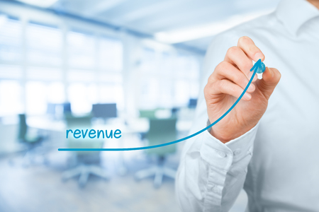 Increase revenue concept. Businessman plan revenue growth, office in background.
