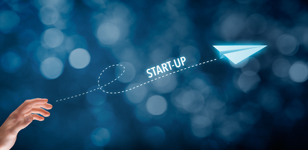Foto de Start-up business concept. Businessman throw a paper plane symbolizing accelerating start-up business. - Imagen libre de derechos