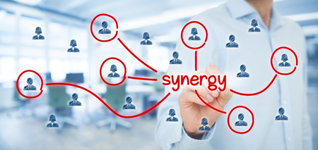 Synergy opportunity concept. Manager (businessman) connect team members with text synergy, cooperating team connected to this text.