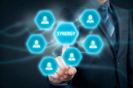 Synergy opportunity concept. Manager (businessman) connect cooperating team members with text synergy.