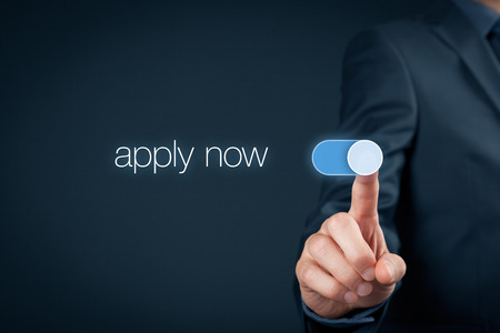 Photo pour Apply now - human resources concept. Businessman switch-on button apply now. - image libre de droit