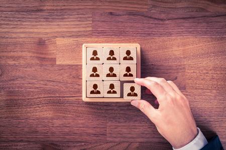 Foto de Human resources, social networking, assessment center concept, personal audit or CRM concept - recruiter complete team by one person. - Imagen libre de derechos