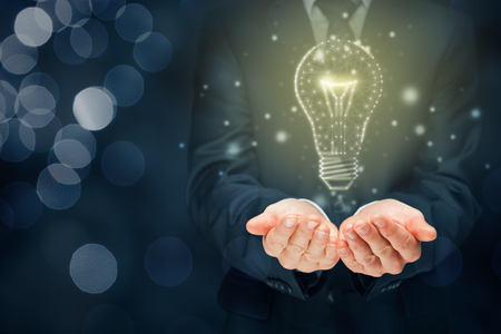 Foto de Creative company give you their creativity and ideas. Hands and graphics light bulb - symbols of idea, creative thinking, innovations and intelligence. - Imagen libre de derechos