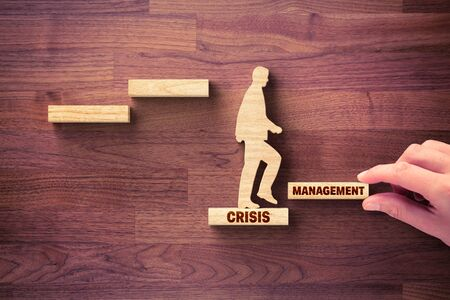 Photo pour The crisis manager helps company overcome crisis to start new growth. Motivation for growth after crisis concept. Post covid-19 era management helping hand concept. - image libre de droit