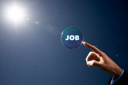 Catch dream job concept. Hand with soap bubble (symbol of dream) with text job inside. Crisis after covis-19 pandemic is opportunity to change the job.
