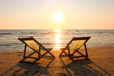 Photo for Beach chairs on the tropical beach and sea at summer sunset time. Empty beach loungers on summer holiday in tropical paradise island. - Royalty Free Image