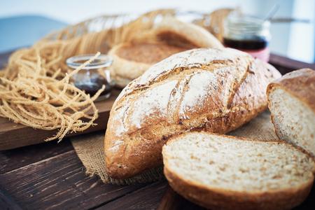 Foto für Fresh Bread On Wooden Table With Butter And Mix Fruit Jam. - Lizenzfreies Bild
