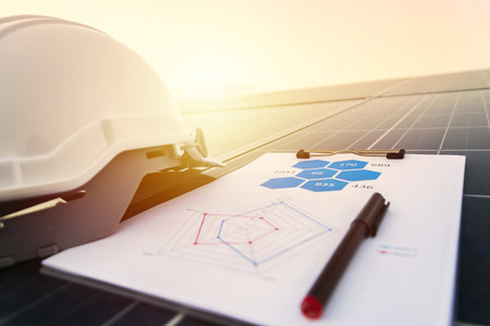 Foto de working solar station photovoltaic panels,Science solar energy,engineer working on checking and maintenance equipment at industry solar power,Chart Section Power consumption. - Imagen libre de derechos