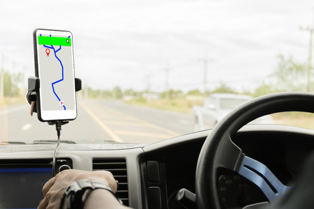 Photo pour Close-up mobile smart phone inside a car, GPS navigation searching destination direction or address on gps map - image libre de droit