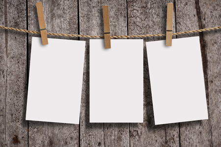 Photo pour Blank three page of white paper with wood clip on wood wall panels, grunge wood background. Blank paper for your text, copyspace or your design. - image libre de droit