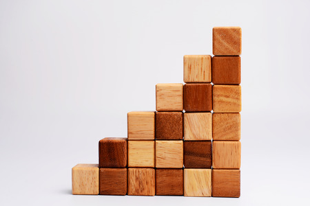 Photo pour Stack of square wood block in statistics graph shape, metaphor to business keep growing and rising. Empty and blank space for your text, design or copyspace.  - image libre de droit
