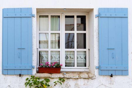 Foto de Old window with wooden blue painted shutters - Imagen libre de derechos