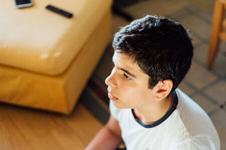 Photo for Head shot of young boy concentrating on playing video games - Royalty Free Image