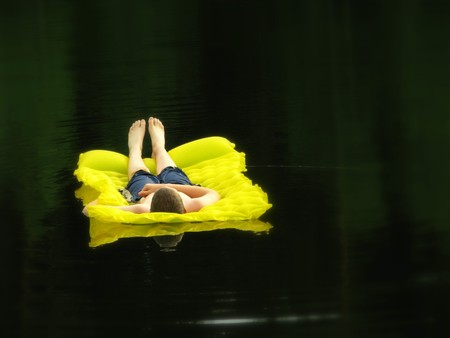 Boy enjoys peaceful floating