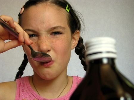 Child taking foul-tasting medicine