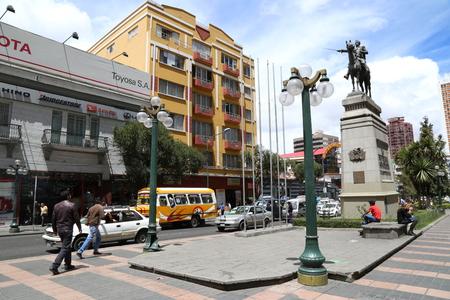 BOLIVIA, LA PAZ, 13 FEBRUARY 2017 - People in El Prado walking street with Simon Bolivar statue in a center of La Paz, Bolivia.