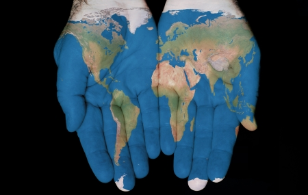 Foto de Map painted on hands showing concept of having The World in our hands - Imagen libre de derechos