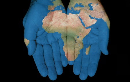 Map painted on hands showing concept of having the Country Of Africa in our hands