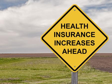 Foto de Caution Sign - Health Insurance Increases Ahead - Imagen libre de derechos