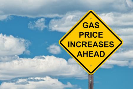 Photo pour Gas Price Increases Ahead Caution Sign Blue Sky Background - image libre de droit