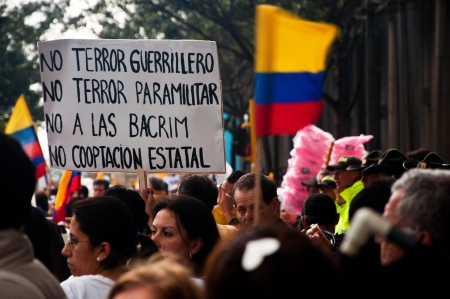 Bogota, Colombia - DECEMBER 6: People lining the streets to protest against the FARC