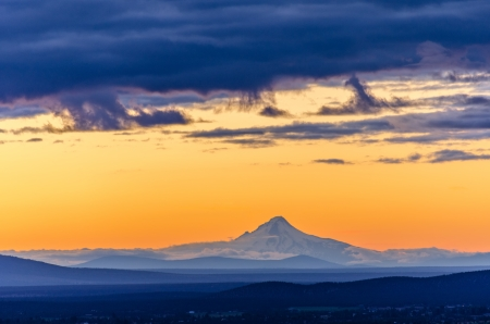 Orange sky over Mt  Hood seen during sunset from Bend, Oregon