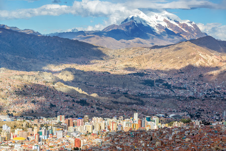 Cityscape of La Paz, Bolivia with Illimani Mountain rising