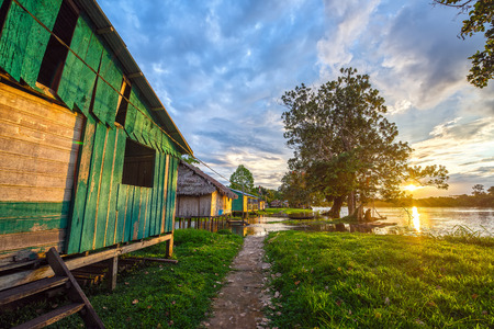 Sunset over the village of Santa Rita in the Amazon rainforest in Peru