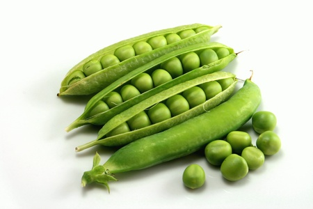 Fresh peas on a white backgroundの写真素材